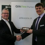 Adrian presenting gift to David Telford of QlikTech